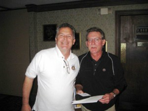 Jonathan Brewer awards Jerry Setchel Longest Drive and Closest to the Pin