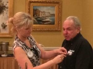 Marcie Salazar pins new member Bob Ieva